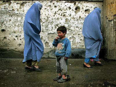 https://imgc.allpostersimages.com/img/posters/a-young-afghan-refugee-boy-stands-in-a-pair-of-adult-s-shoes_u-L-Q10OPHM0.jpg?p=0