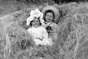 A Young Brother and Sister Nestled in the Hay, Ca. 1900
