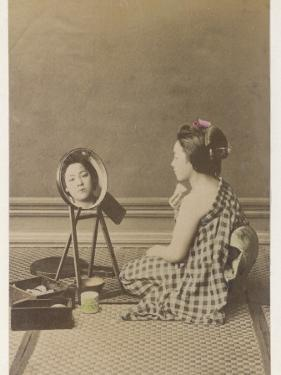 A Young Geisha Applies Her Characteristic Make-Up