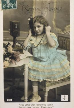 A Young Girl on the Line Holding the Ear-Phones to the Side of Her Head