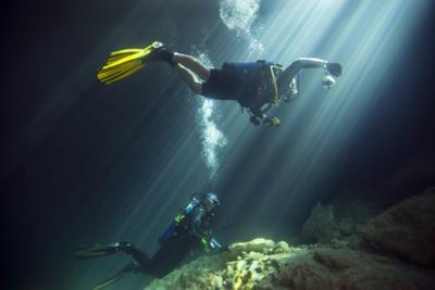 A Young Married Couple Scuba Diving in Devil's Den Springs Florida