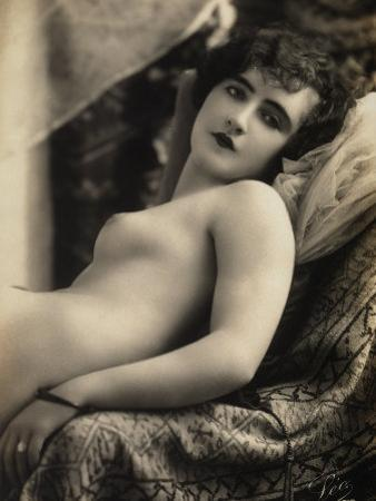 A Young Woman Posing Nude on a Couch