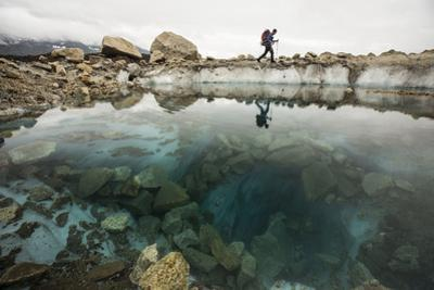 A Climber Hikes Near a Glacial Pool on Lower Ruth Glacier in Denali National Park by Aaron Huey