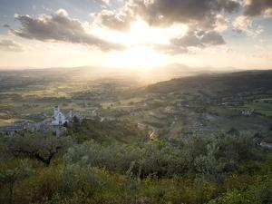 A Dramatic Sunset and the Village of Assisi by Aaron Huey