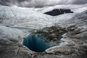 A glacial pool and stream on lower Ruth Glacier in Denali National Park and Preserve. by Aaron Huey