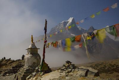 A stupa and prayer flags overlooking the village of Dingboche by Aaron Huey