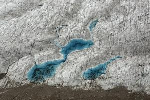 Aerial View of Glacial Pools on Ruth Glacier in Denali National Park and Preserve by Aaron Huey