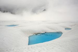 Glacial pools atop upper Ruth Glacier in Denali National Park. by Aaron Huey