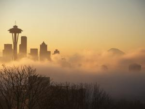 Morning Fog around Skyline with Sihouette of Space Needle and City Buildings by Aaron McCoy