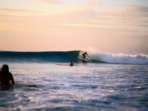 Surfing at Avellanas Beach, Nicoya Peninsula by Aaron McCoy