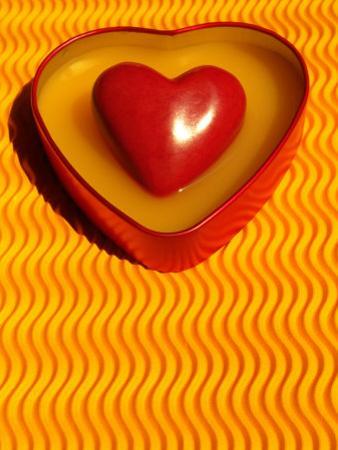 A Love Stone Heart with Yellow Background by Abdul Kadir Audah