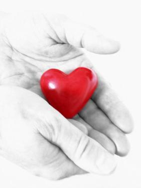 Holding Heart in Hands by Abdul Kadir Audah