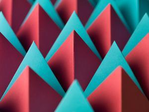 Abstract Geometrical Background with Colorful Paper Pyramids. Selective Focus by Abstract Oil Work