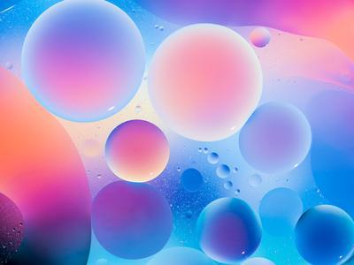 Circular Oild Drops on Water Surface with Colorful Bright Background