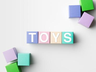 Multicolored Blocks with Toys Word Written on Them, on White. Copy Space Available