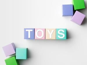 Multicolored Blocks with Toys Word Written on Them, on White. Copy Space Available by Abstract Oil Work