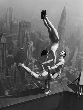 Acrobats Performing on the Empire State Building