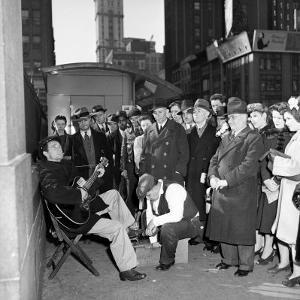 Activist Folk Musician Woody Guthrie Playing for a Crowd of New Yorkers