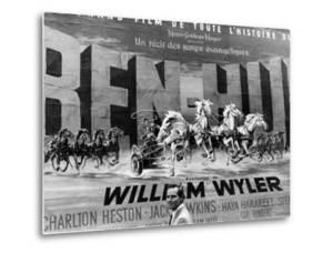 Actor Charlton Heston Posing in Front of Billboard of Film, Ben Hur