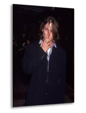 Actor Johnny Depp Smoking a Cigarette