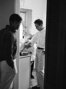 Actor Paul Newman Cooking Eggs for Guests Incl. Anthony Perkins During an Informal Party