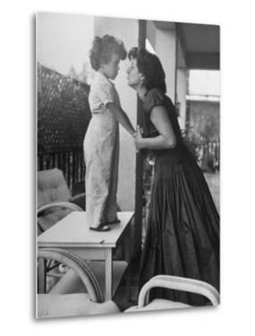 Actress Anna Magnani Posing with Child Standing on Table