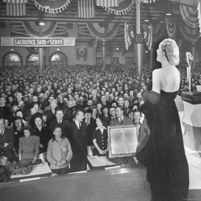 https://imgc.allpostersimages.com/img/posters/actress-carole-lombard-performing-to-help-sell-war-bonds-during-rally_u-L-P43LRD0.jpg?p=0