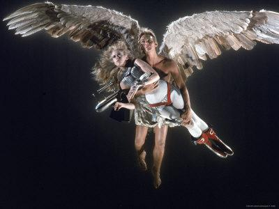 https://imgc.allpostersimages.com/img/posters/actress-jane-fonda-being-carried-by-guardian-angel-in-a-scene-from-roger-vadim-s-film-barbarella_u-L-P43C8N0.jpg?artPerspective=n