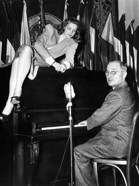 Actress Lauren Bacall Sits Atop the Piano While Vice President Harry Truman Plays