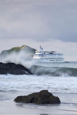 A Cruise Ship Lies Anchored Behind Crashing Waves Near Manuel Antonio, Costa Rica by Adam Barker