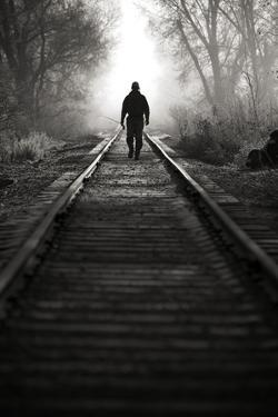 A Male Angler Walks Down Train Tracks Near the Middle Provo River in Winter in Utah by Adam Barker
