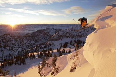 A Young Male Skier Jumps of the Side of a Mountain at Alta, Uthah
