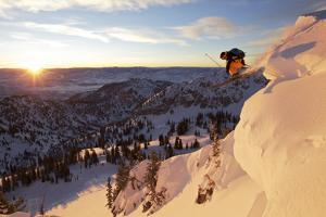 A Young Male Skier Jumps of the Side of a Mountain at Alta, Uthah by Adam Barker