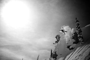 A Young Male Skier Jumps Off the Side of a Mountain at Alta, Utah by Adam Barker