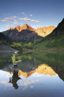 Angler Geoff Mueller Fly Fishing on a Lake in Maroon Bells Wilderness, Colorado by Adam Barker