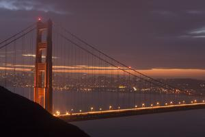 Golden Gate Bridge at Dawn with San Francisco City Lights in the Background by Adam Barker