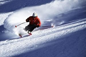 Male Skier Traveling Down the Slopes at Alta, Utah by Adam Barker