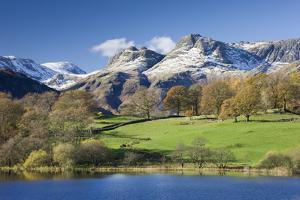 Autumn Colours Beside Loughrigg Tarn with Views to the Snow Dusted Mountains of the Langdale Pikes by Adam Burton
