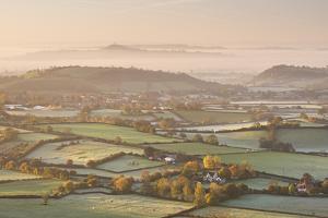 Dawn View over Misty Somerset Levels Countryside Towards Glastonbury Tor, Somerset, England by Adam Burton