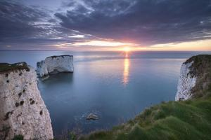 Sunrise over Old Harry Rocks, Jurassic Coast, Dorset, England. Spring by Adam Burton