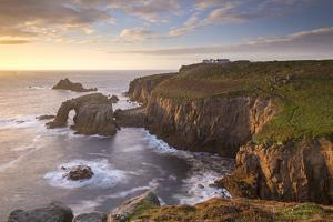 Sunset over Land's End on the western tip of Cornwall, England. Autumn (September) 2015. by Adam Burton