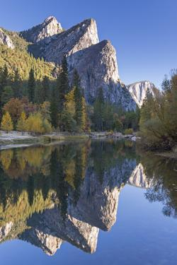 The Three Brothers Reflected in the Merced River at Dawn, Yosemite Valley, California by Adam Burton