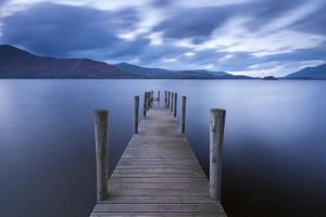 Wooden Jetty on Derwent Water in the Lake District, Cumbria, England. Autumn by Adam Burton