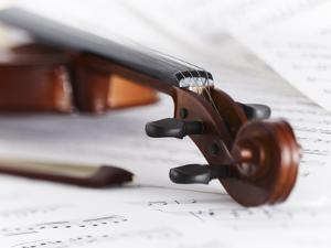 Close up of Violin, Bow and Sheet Music by Adam Gault
