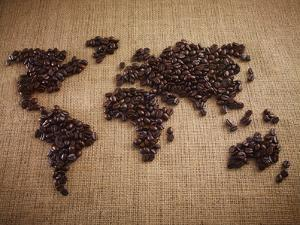 Coffee Beans Forming World Map on Burlap by Adam Gault