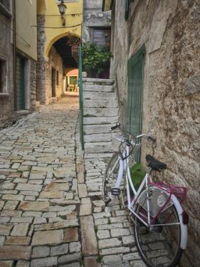 Bicycle and Cobblestone Alleyway, Rovigno, Croatia by Adam Jones