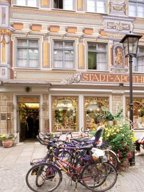Bicycles Parked in Street, Fussen, Germany by Adam Jones