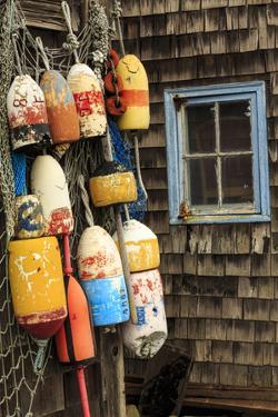Buoys and netting and old window, Rockport, Massachusetts by Adam Jones