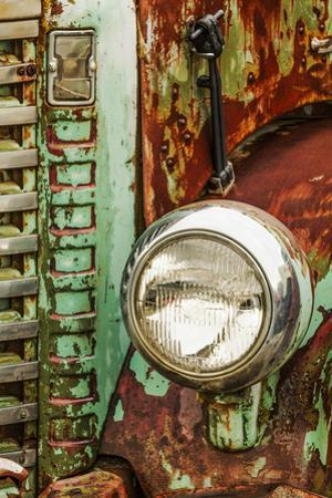 Close-up on headlight of old truck, Palouse region of Eastern Washington State. by Adam Jones