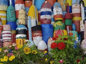 Colorful Buoys on Wall, Rockport, Massachusetts, USA by Adam Jones